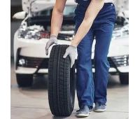 mechanic-holding-tire-repair-garage-260nw-789916777 (2)